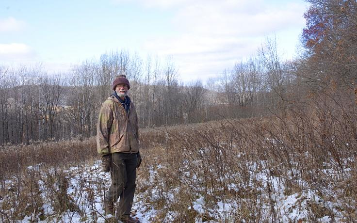 Lennie Lichter surveying his 101-acre wildlife haven